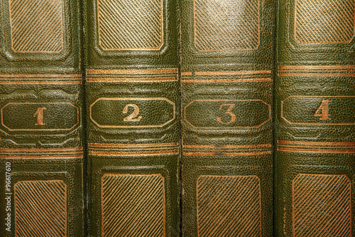 Volumes of old books with gold lettering on the cover Fototapet
