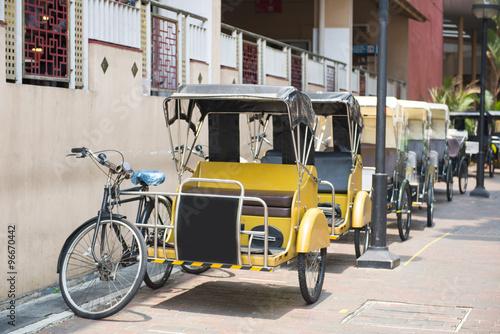 Cadres-photo bureau Londres bus rouge Pedicab service for travel in Singapore town
