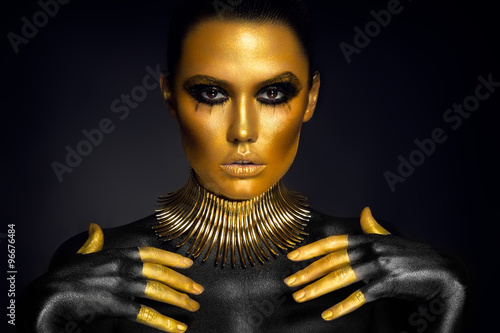 Acrylic Prints Beautiful woman portrait in gold and black colors