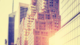 Vintage toned high key picture of skyscrapers against sun, NYC. - 96688442