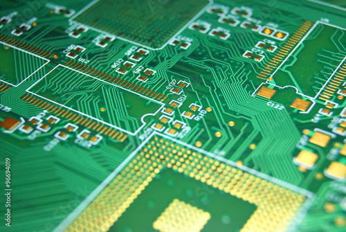 Fotografiet  Printed circuit board closeup green electronic background
