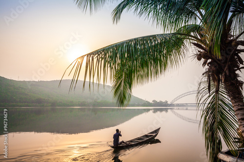 Poster Afrique Paddling in traditional wooden canoe