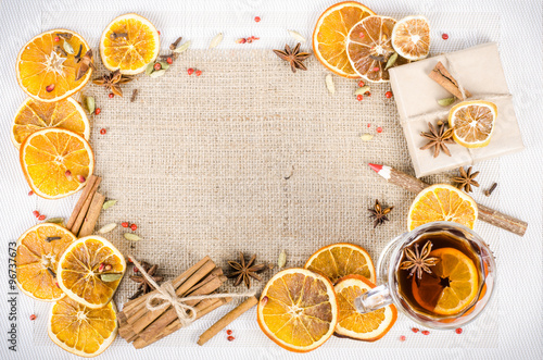 Tuinposter Kruiderij Dried oranges, cinnamon, cloves, cardamom, handmade milk chocolate with nuts, mulled wine, wooden pencil on sackcloth, canvas. Christmas, New Year and winter. Free space for your text.
