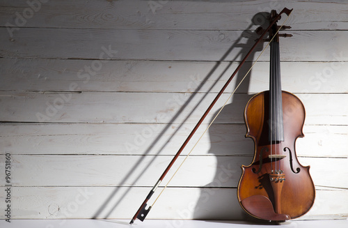 Vintage violin on the white wooden background. Wallpaper Mural