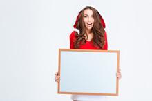 Cheerful Woman In Santa Claus Cloth Holding Blank Board