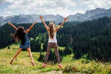 Two Girls Happy Jump In Mounta...