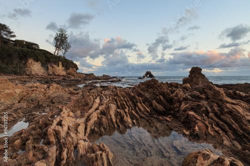 Long exposure at Little Corona Beach in Corona del Mar, California at sunset #96787255