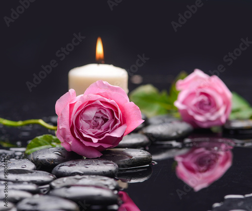 Fotobehang Spa Lying down pink rose ,candle and wet stones
