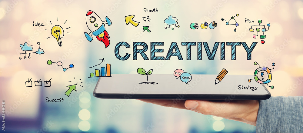 Fototapety, obrazy: Creativity concept with man holding a tablet
