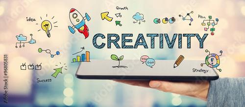 Obraz Creativity concept with man holding a tablet - fototapety do salonu