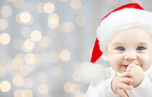 Happy Baby In Santa Hat Over H...