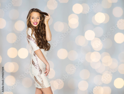 happy young woman or teen in dress over lights Wall mural