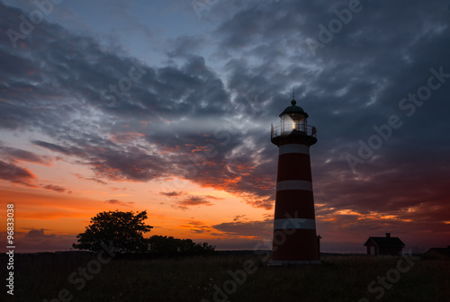 Photo sur Toile Phare Lighthouse, Gotland - The Närsholmen lighthouse on the island Gotland, Sweden at dusk.