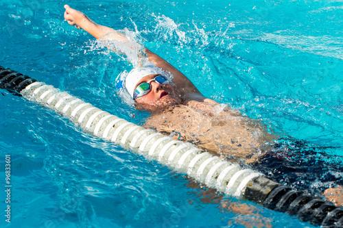 Teen backstroke swimmer in action. Canvas Print