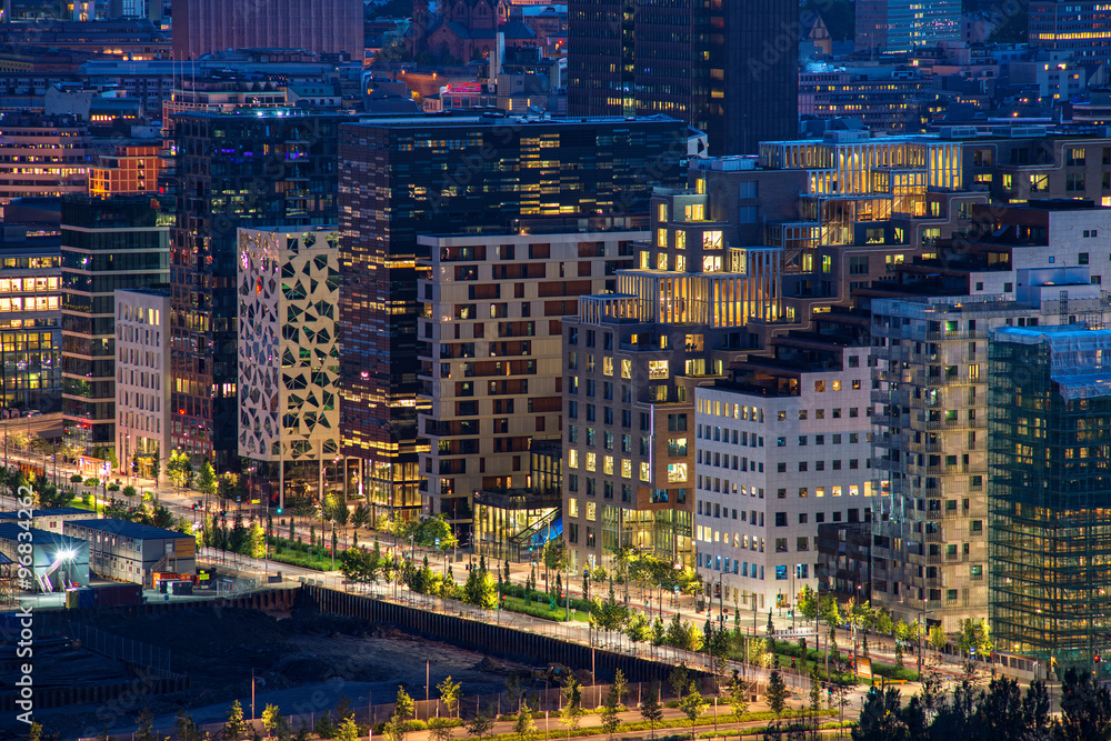 Fotografering  Oslo, Norway - July 15, 2015: Night view of illuminated street in the Oslo business center