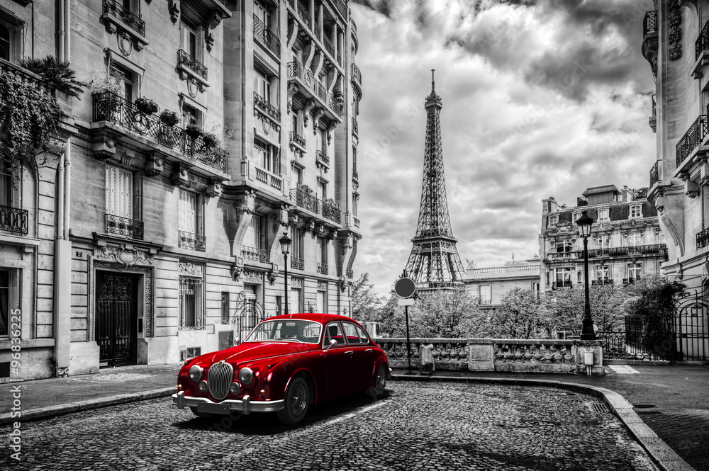Fototapeta Artistic Paris, France. Eiffel Tower seen from the street with red retro limousine car.