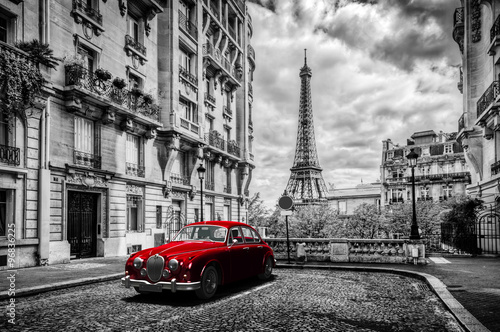 Poster Eiffel Tower Artistic Paris, France. Eiffel Tower seen from the street with red retro limousine car.