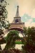 Eiffel Tower from Champ de Mars park in Paris, France. Vintage