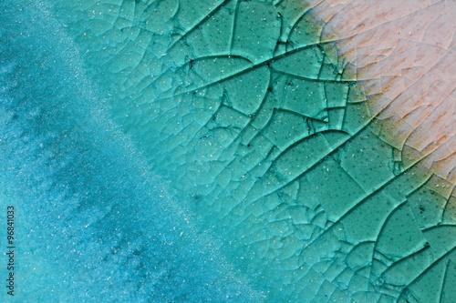 Tableau sur Toile Closeup macro shot of cracked raku clay pottery.