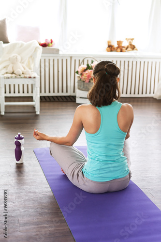 The girl in the lotus position. meditation, yoga studio