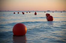 Buoys At Sunset