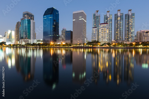 Foto op Canvas Restaurant Water reflection of city downtown during twilight