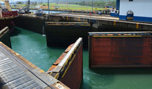 Doors Of The Panama Canal Open For An Approaching Ship