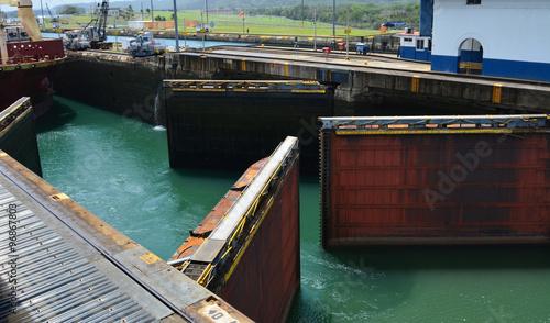 Doors of the Panama Canal open for an approaching ship Fototapeta