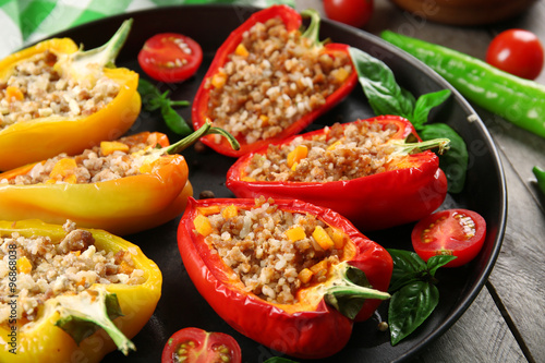 In de dag Buffet, Bar Stuffed peppers with vegetables on table close up