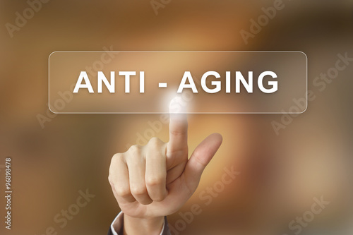 Fotografía  business hand clicking anti aging button on blurred background