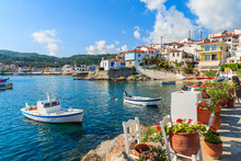 Flowers On Shore With Fishing Boats In Kokkari Port, Samos Island, Greece