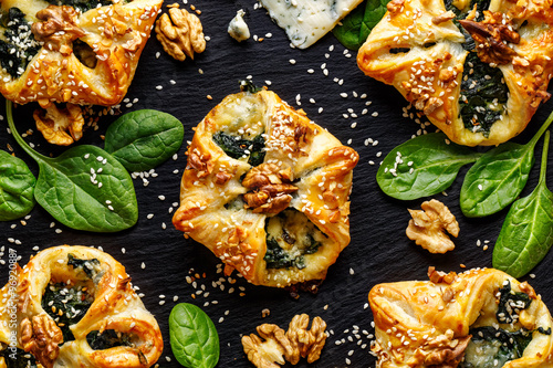 Spinach puffs with addition of gogonzola cheese, walnuts and sesame seeds