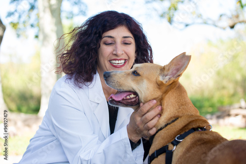 Fotografie, Obraz  Closeup portrait, sweet moments healthcare professional in white lab coat with d