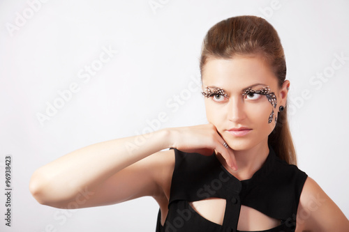 f50d3279e3b Beautiful woman with big eyelashes and face-art - Buy this stock ...