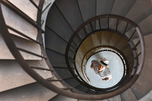 Spiral Staircase With A Man Be...