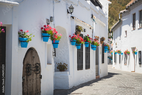 Fototapeta Picturesque street of Mijas. Charming white village in Andalusia