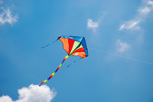 Colorful Kite Flying In The Wind