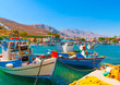 canvas print picture traditional fishing boats  docked at the port of Vathi village in Kalymnos island in Greece