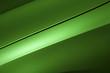 Surface of green sport sedan car, detail of metal hood and fender of vehicle bodywork