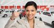 Car dealer woman with key.