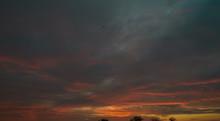Sun Rising Through Clouds