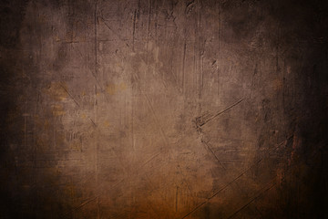brown grunge background or texture with black vignette borders