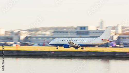 Fototapeta Panning view of an airplane taking off or landing obraz na płótnie