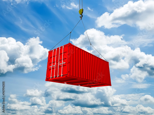 Fotografia  Freight shipping container hanging on crane hook