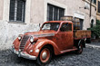 Rustic delivery car in old Rome.
