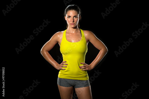 Fotografie, Obraz  Attractive fit thin slim toned female body athlete isolated on black standing co