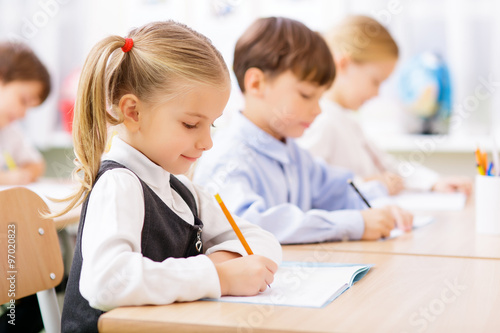 Fotografie, Tablou  Pupils are writing in their copybooks
