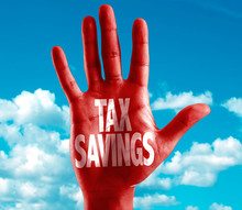Tax Savings Written On Hand With Sky Background
