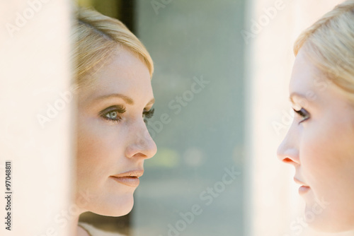 Fotografie, Obraz  Woman looking at her reflection