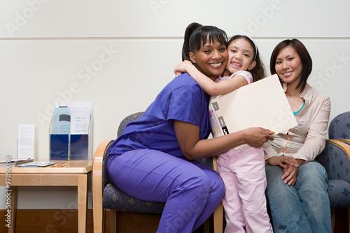 Fotografie, Obraz  Girl hugging nurse